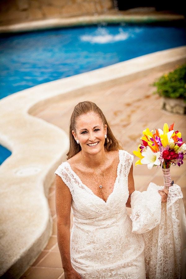 Bride at pool in La Mansion Inn