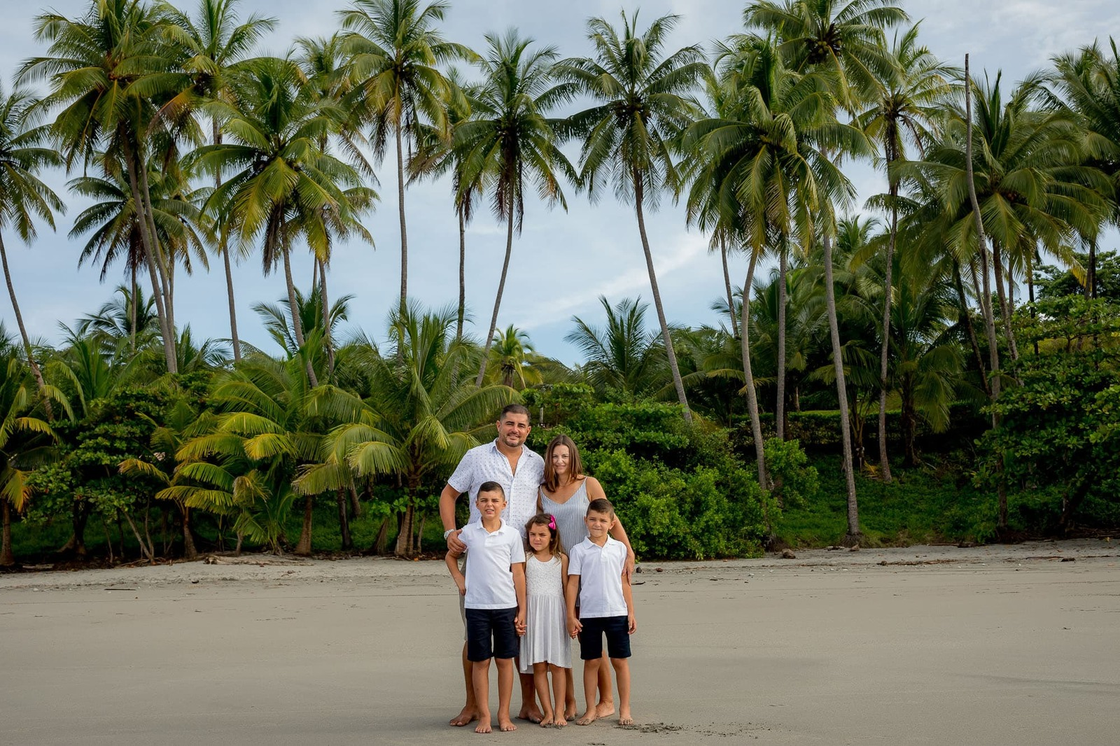family photo with palm trees