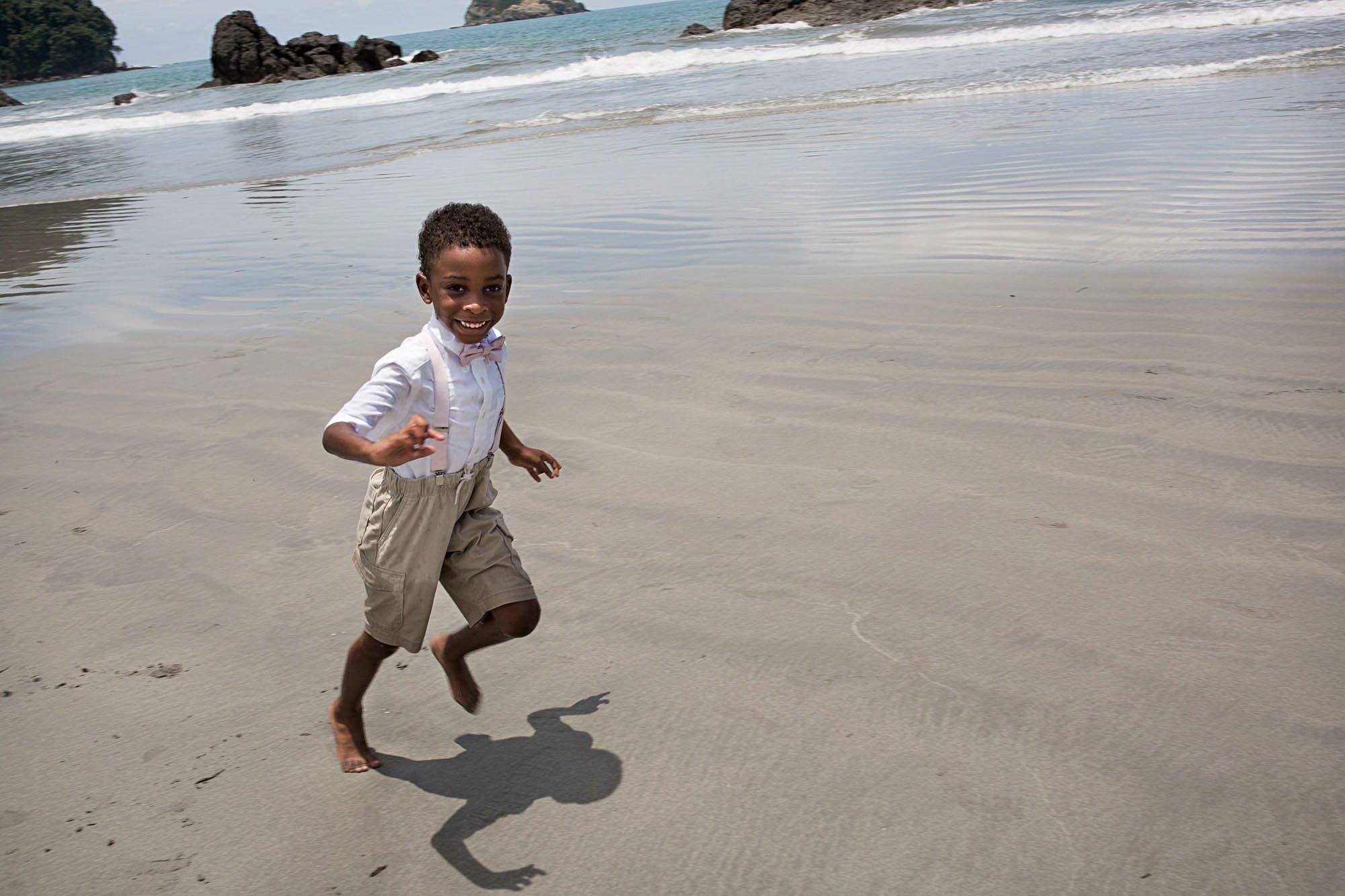 kid running on beach