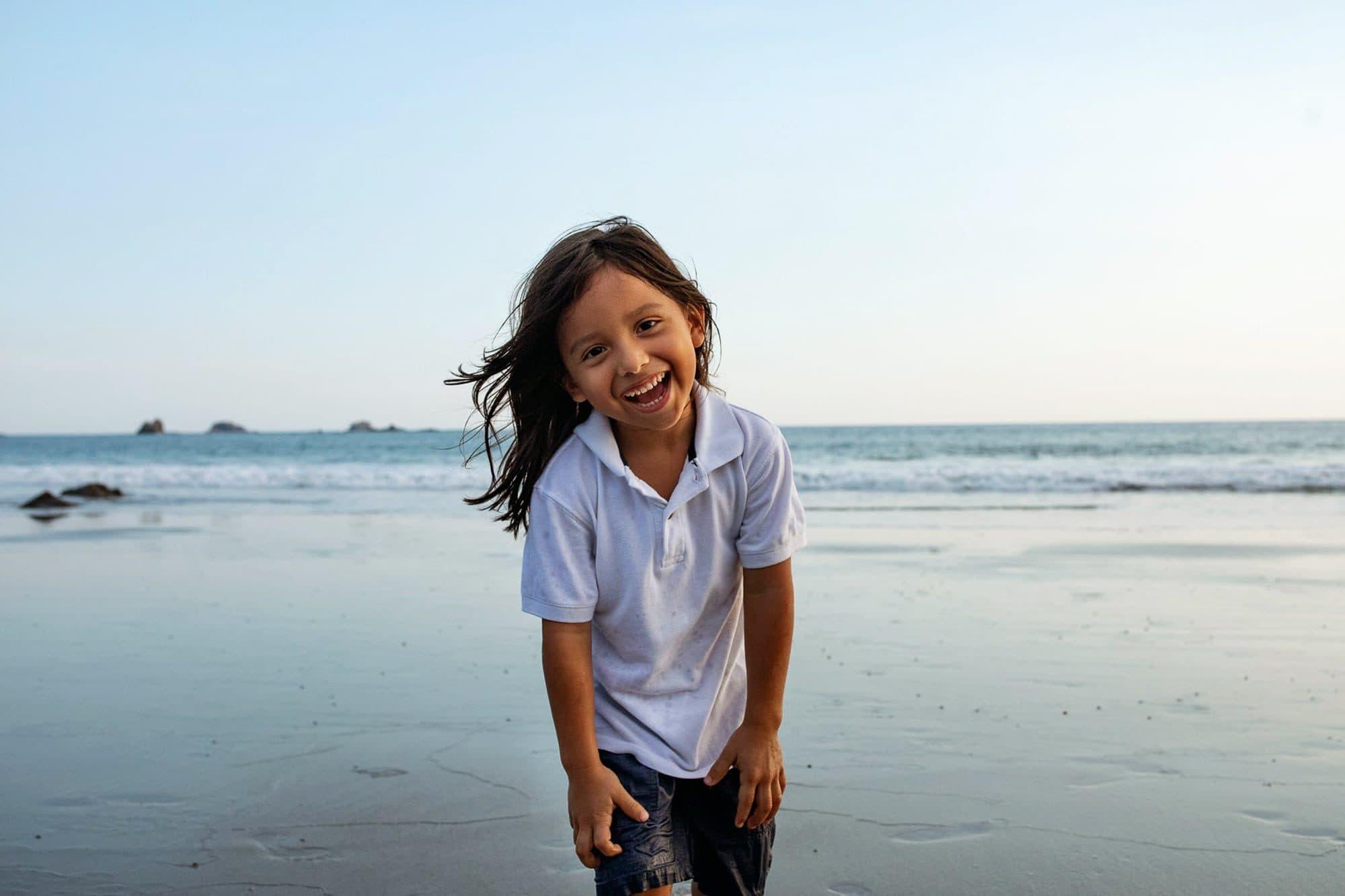 kid on beach in costa rica