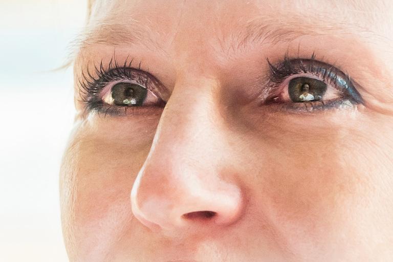 reflection of groom in bride's eyes.