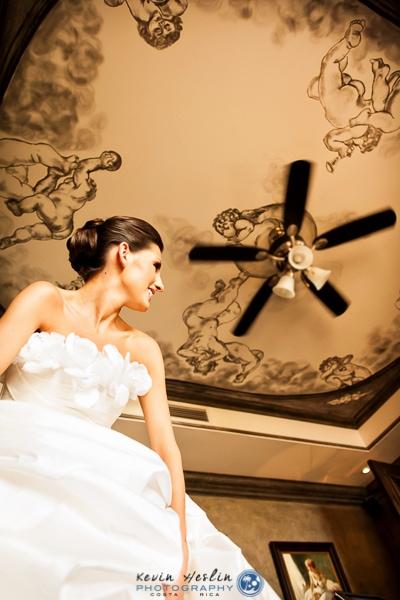 Bride putting on dress in Villas Caletas.