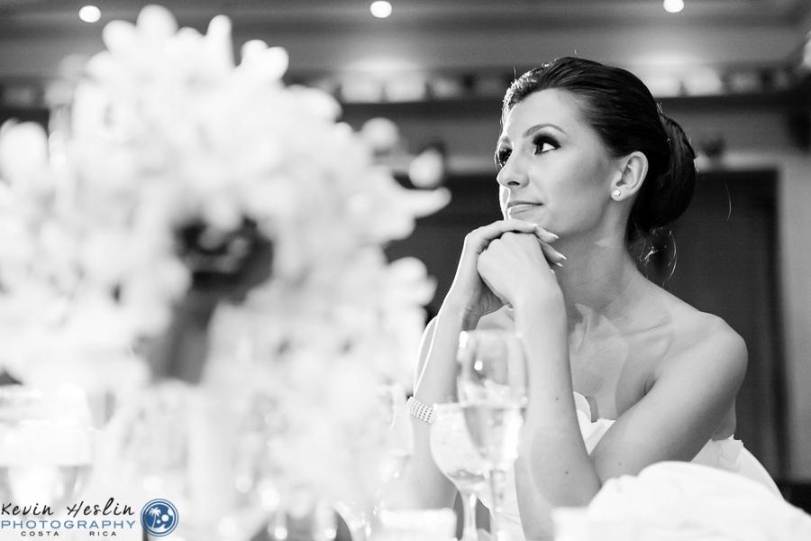 Bride during speeches at wedding.