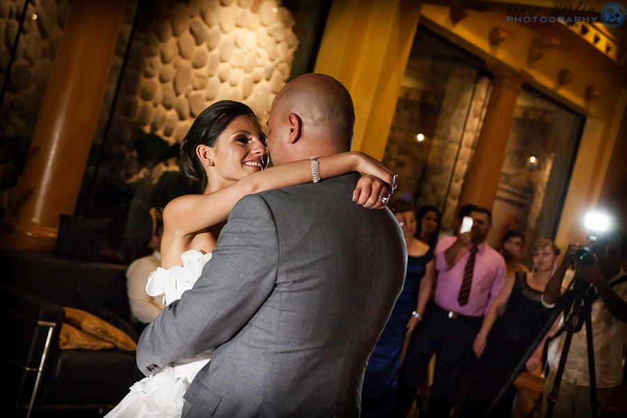 Bride and groom dance at holiday wedding.