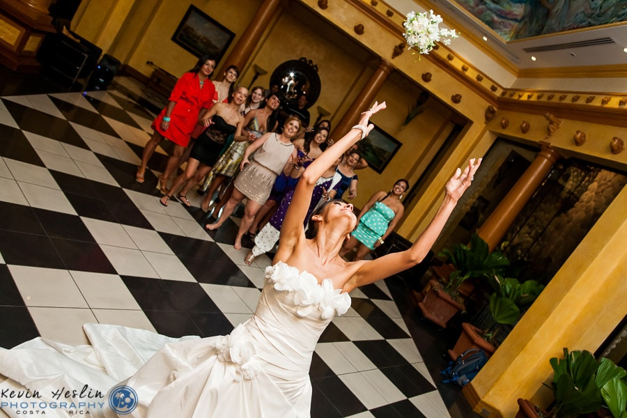 Bride throwing bouquet at wedding.