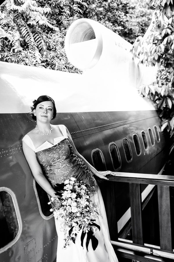 Bride next to plane.