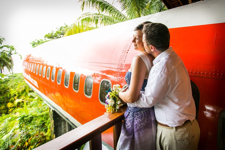 Wedding couple by plane in Costa Rica.