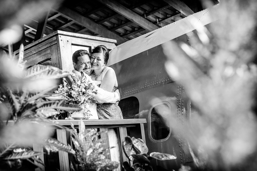 Bride and groom by plane during wedding