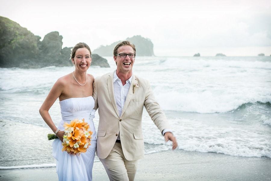 Wedding couple laughing.