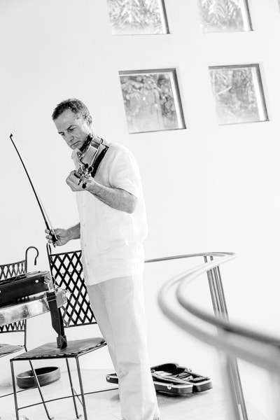Father of bride plays violin at wedding
