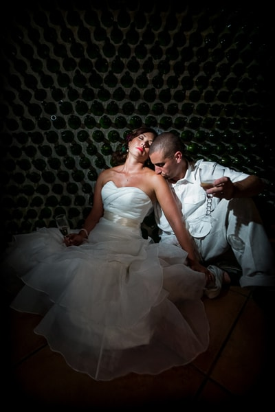 Bride and groom in wine room.