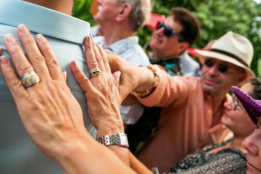 Hands on wedding couple in Casa Romanitca