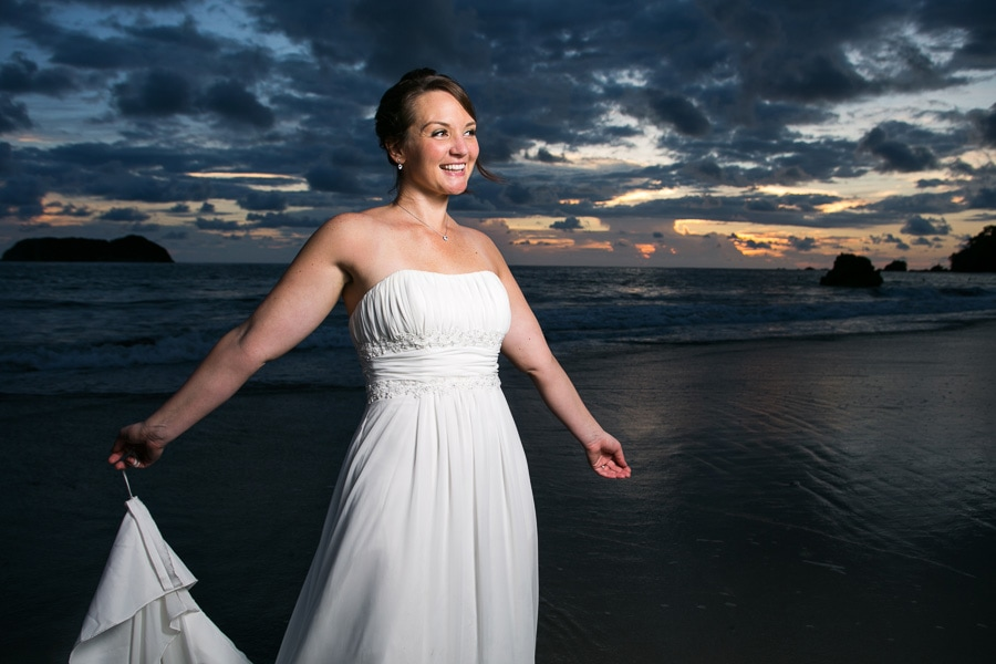 Bride at beach for sunset in Costa Rica.