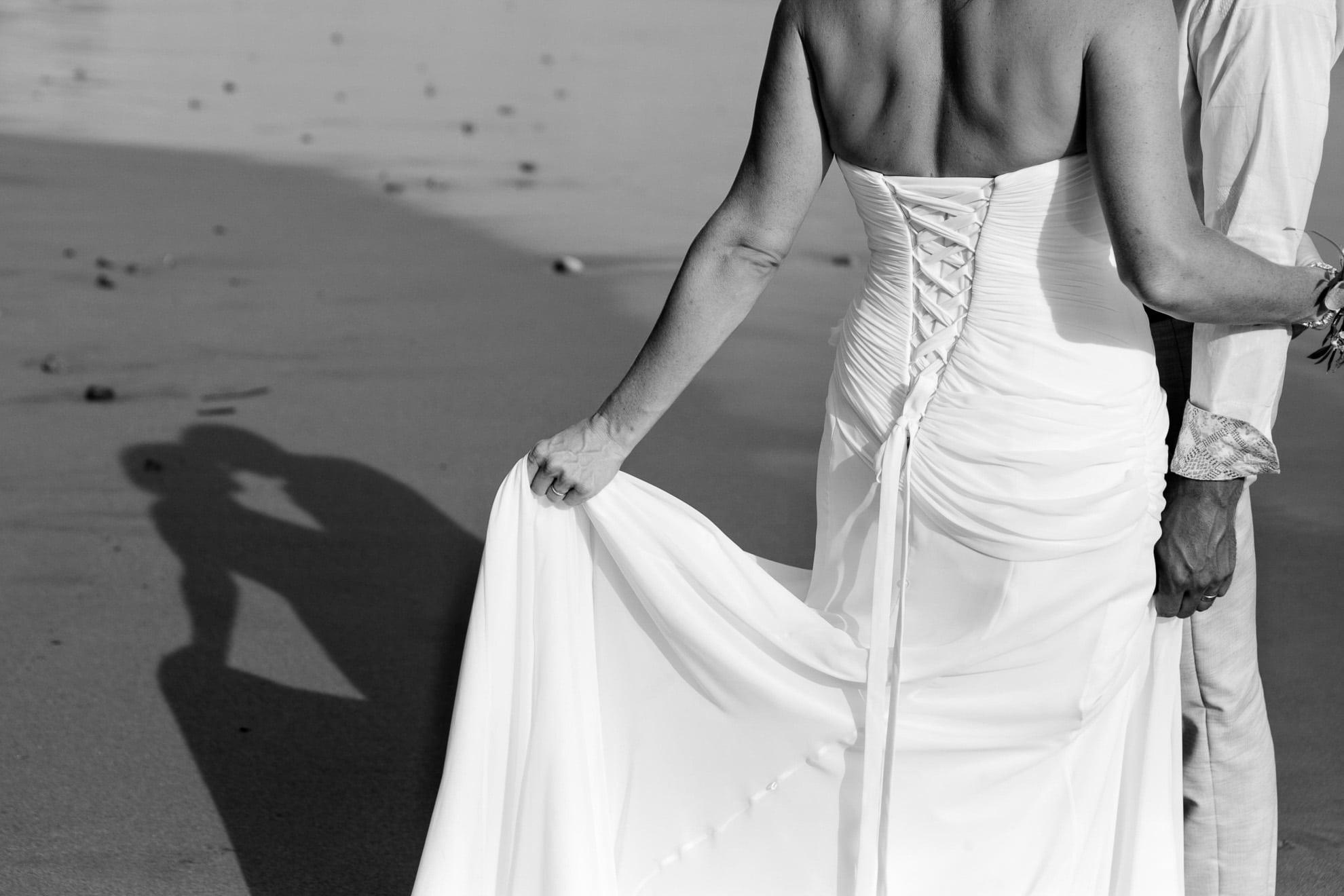 bride in her wedding dress at beach