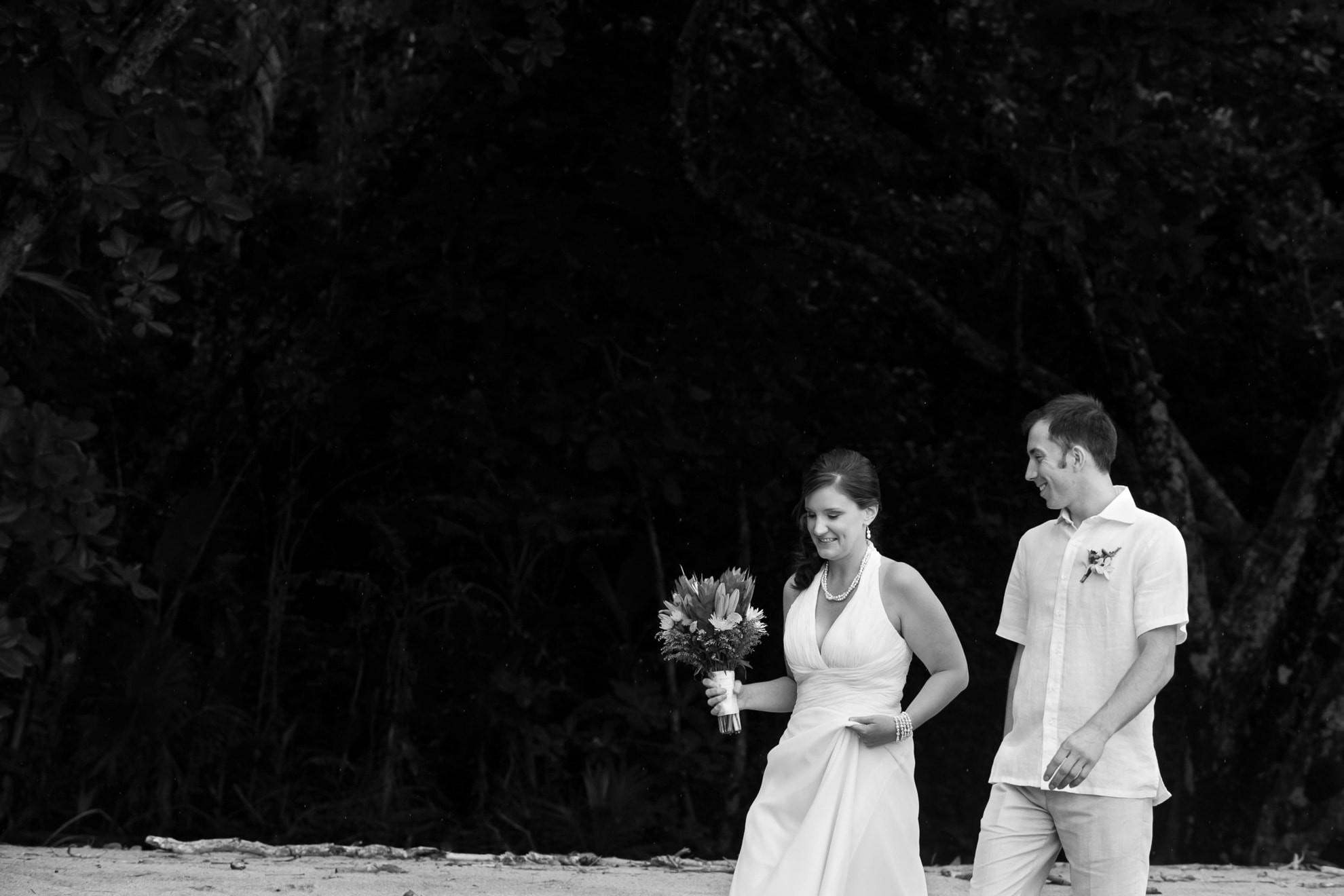 Bride and groom walking to ceremony in Costa Rica.