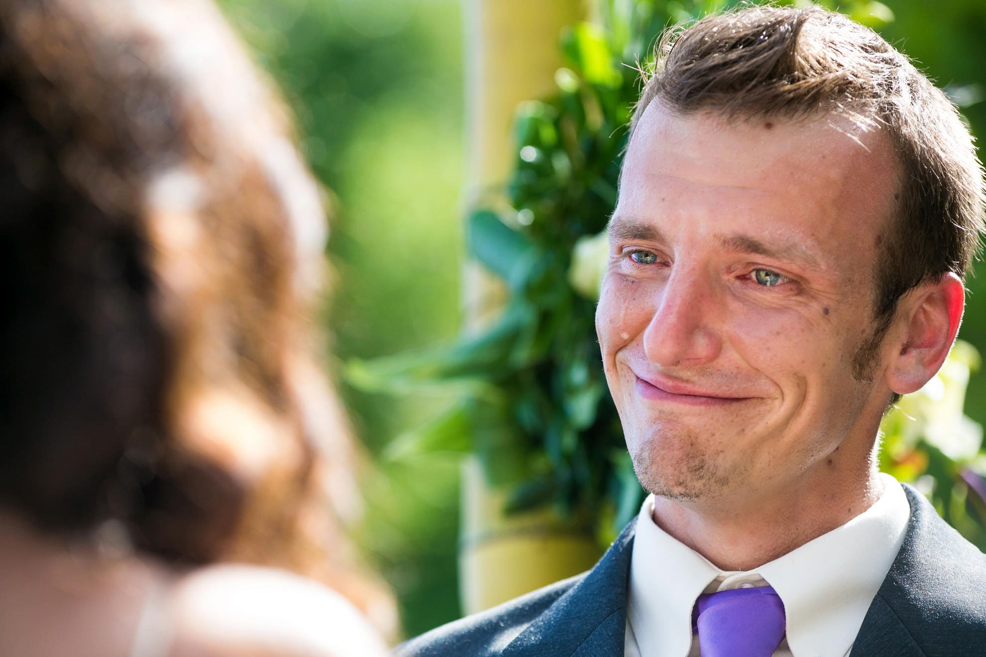 Groom crying when he sees his bride.