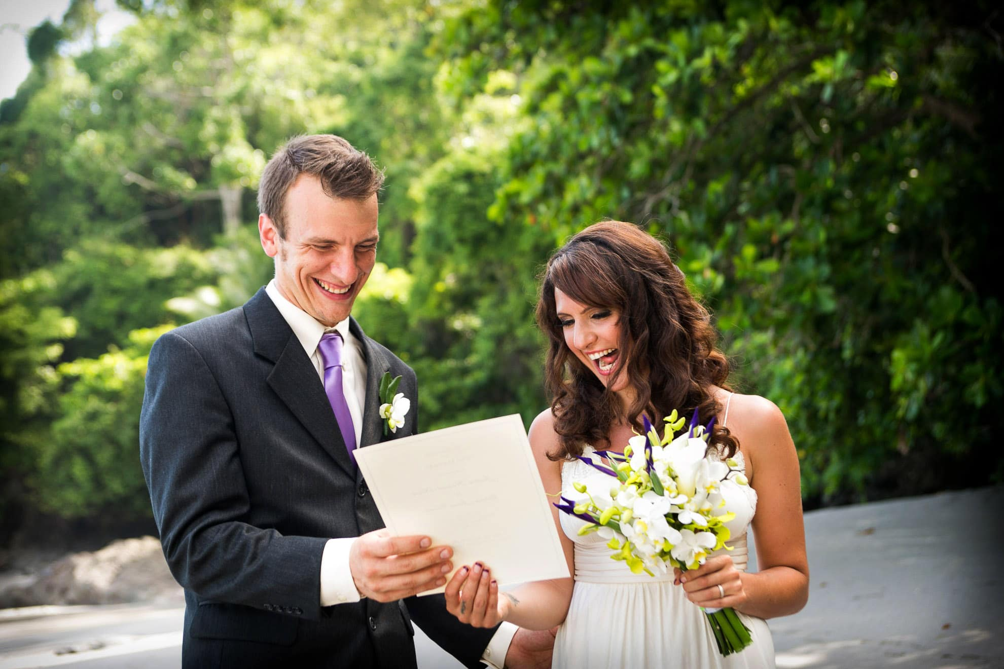 Bride and Groom excited to see their wedding certificate.