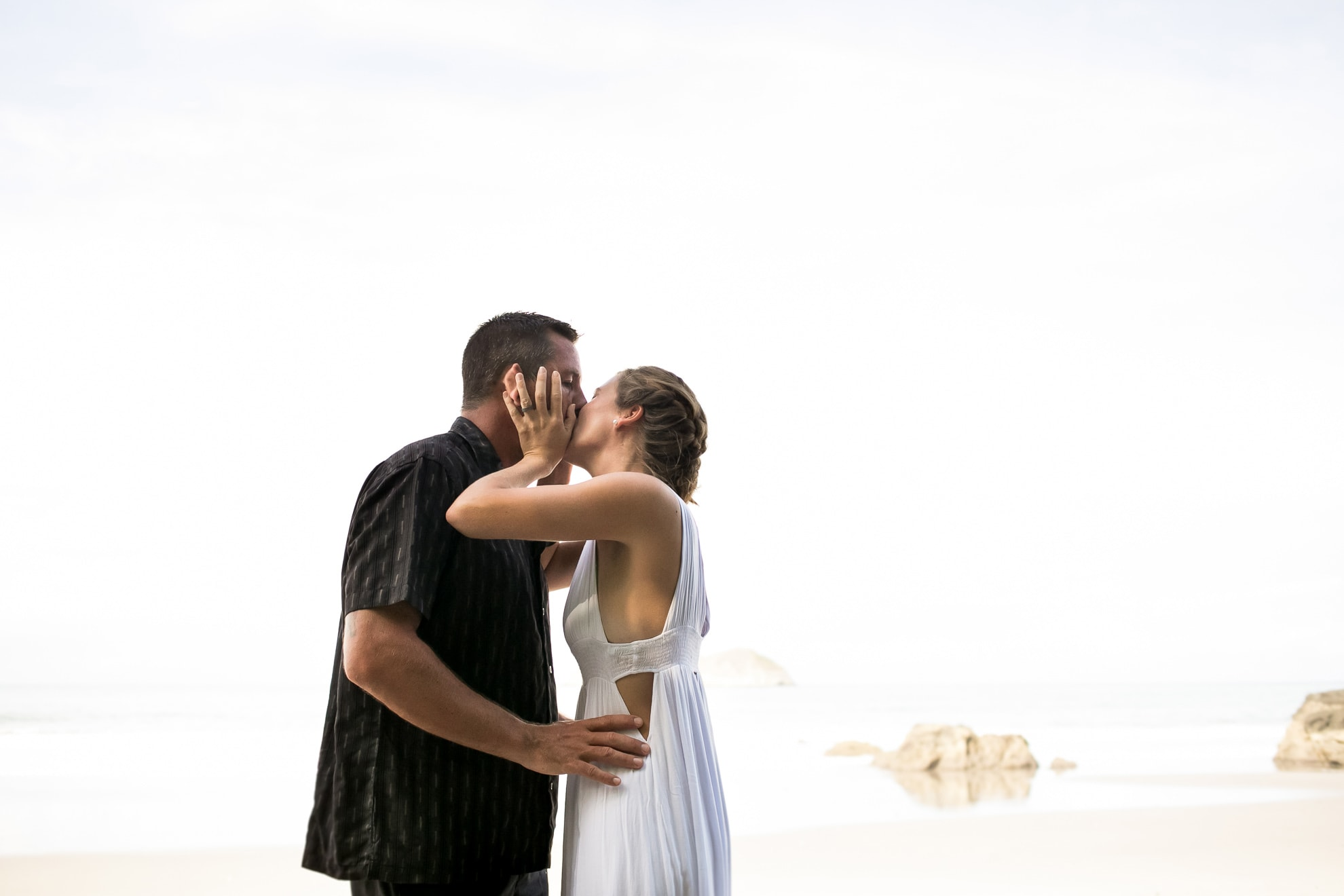 Kiss on beach in Costa Rica.