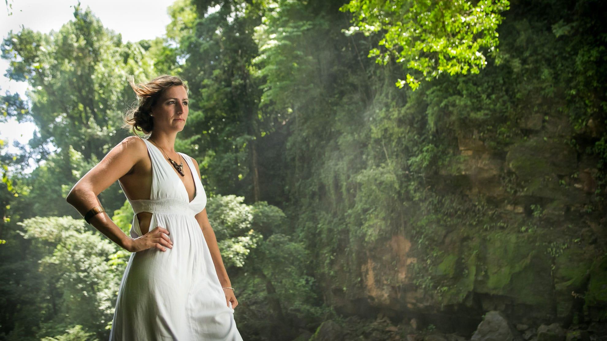 Bride in wedding dress at Waterfall.