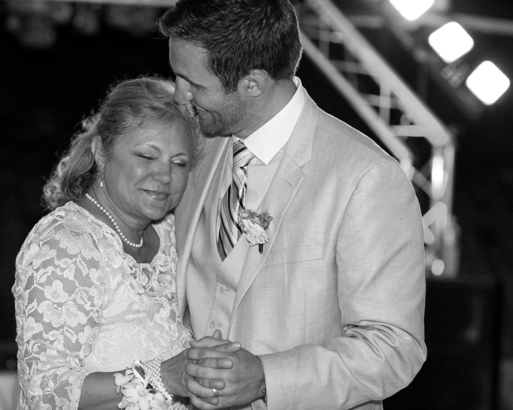 Sweet moment during the mother son dance at wedding in Costa Verde. Love candid photography!