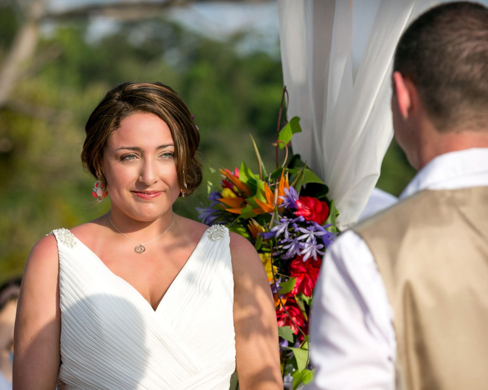 Bride looking at groom during wedding