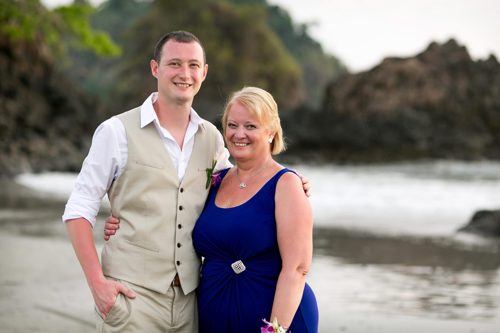 Groom with mother on beach in Costa Rica.