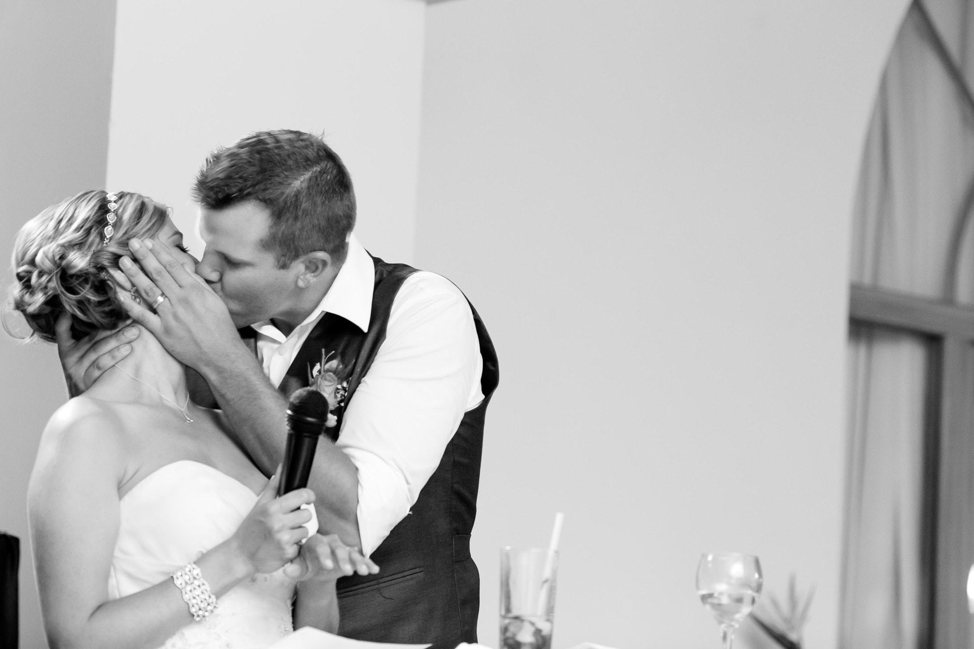 Groom kisses wife during wedding speeches