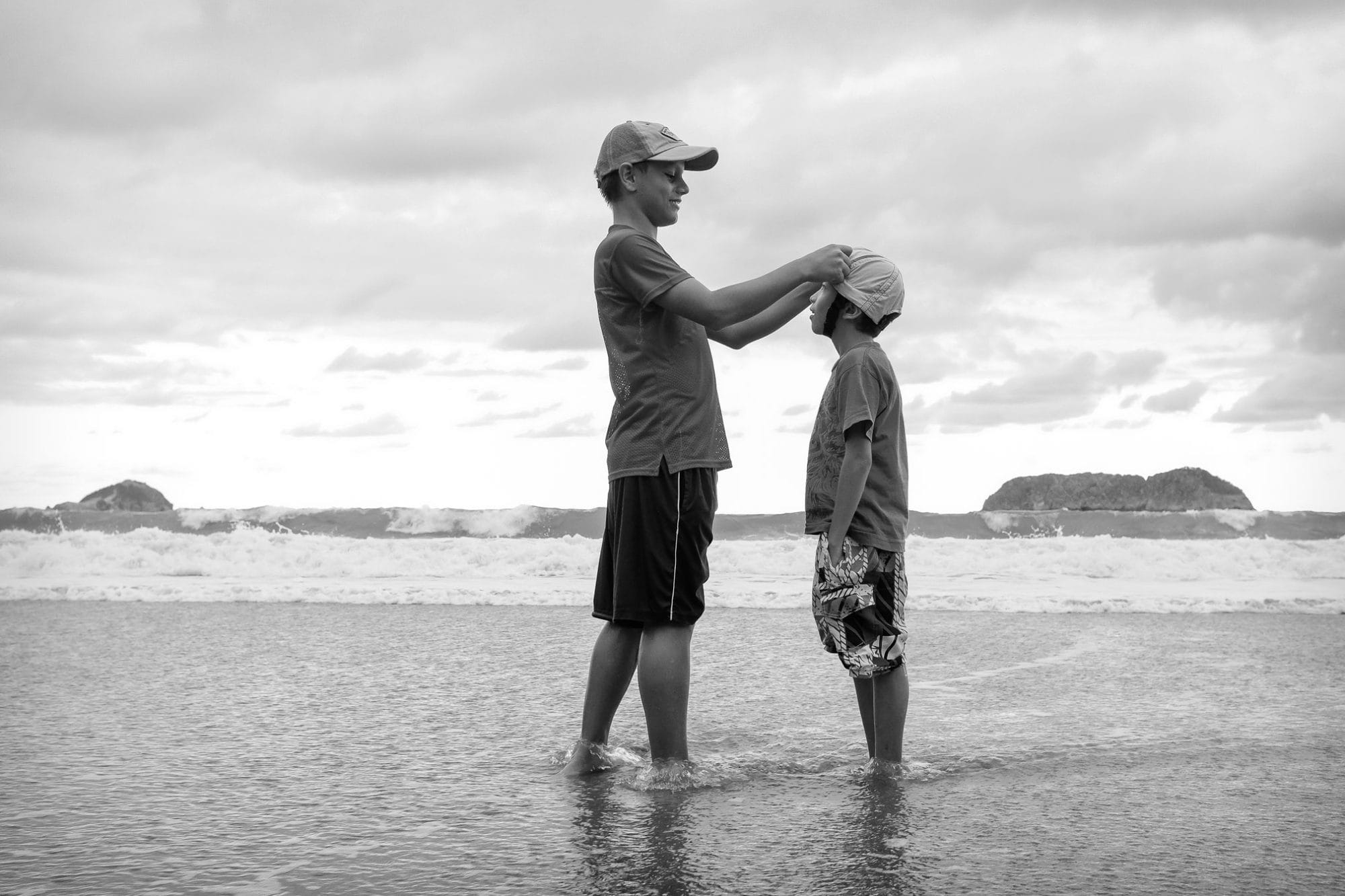 Brothers on beach in Costa Rica