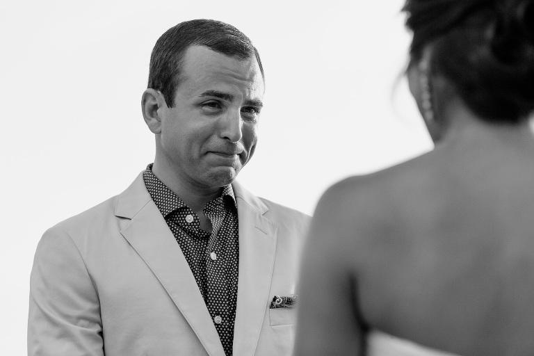 Groom tears up at wedding ceremony.