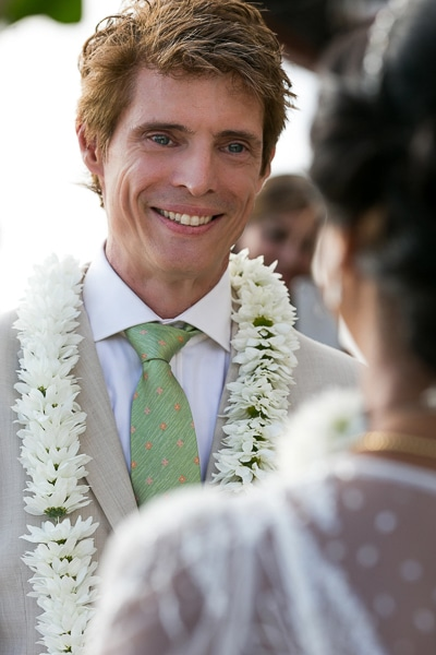 Groom looking at bride during ceremony.