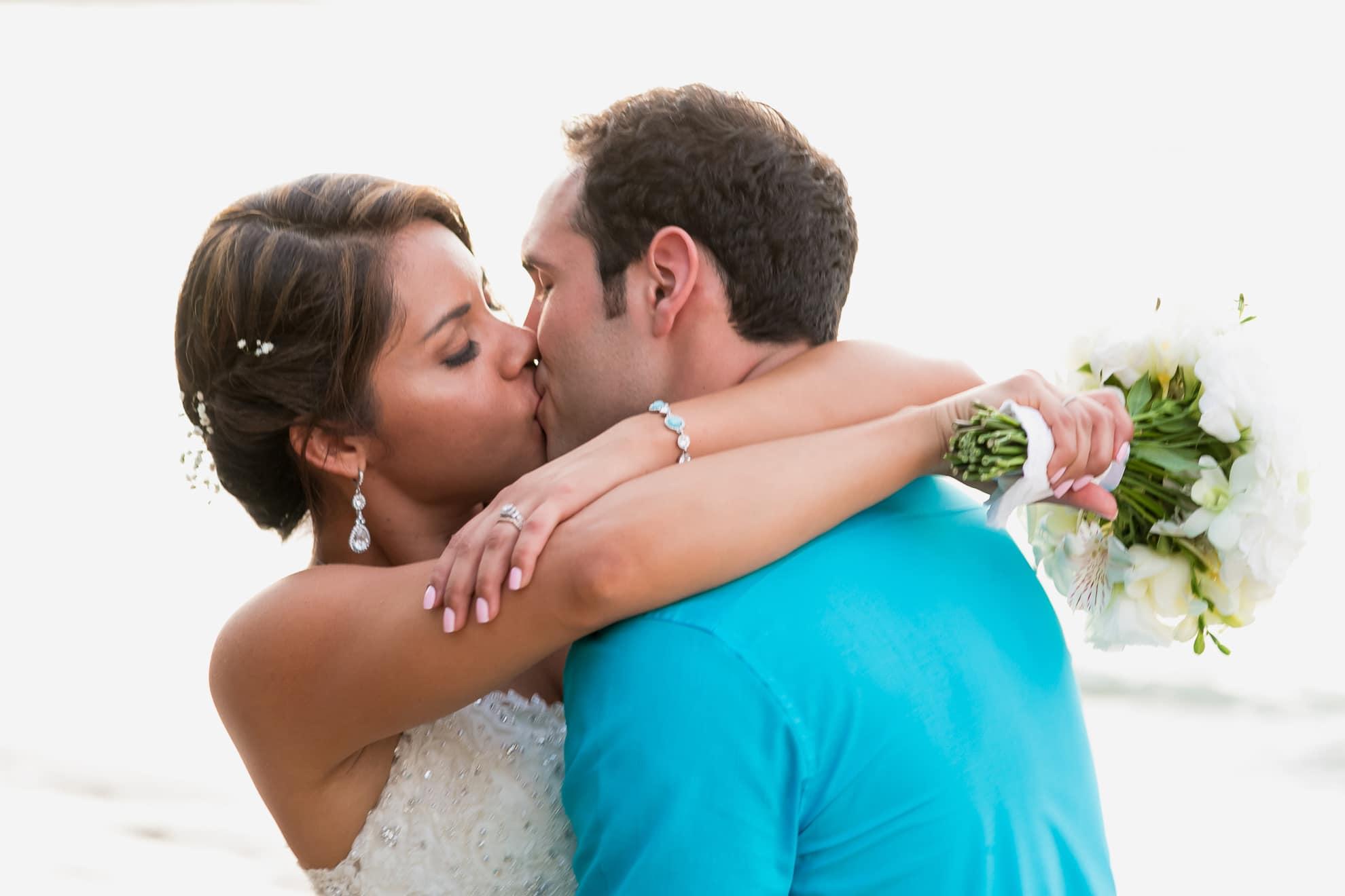First kiss at beach wedding.