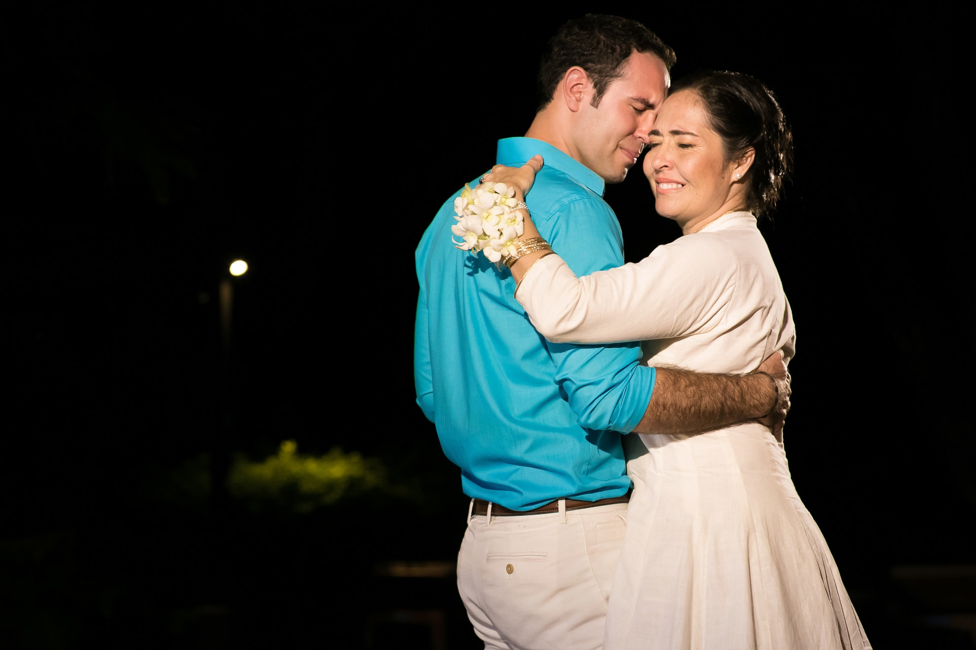Groom dances with mother at wedding in Costa Rica.