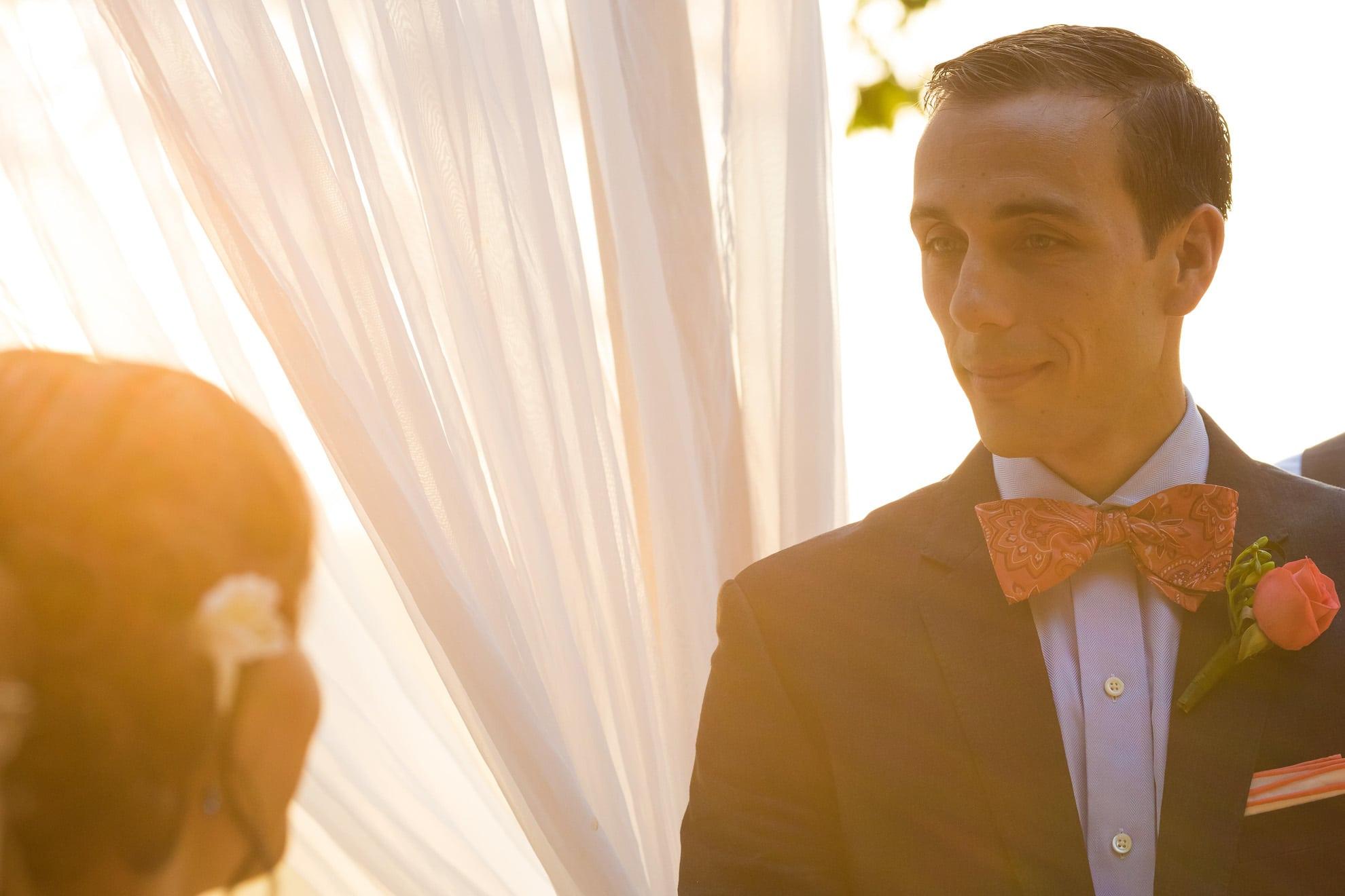 Groom looking at bride at wedding ceremony