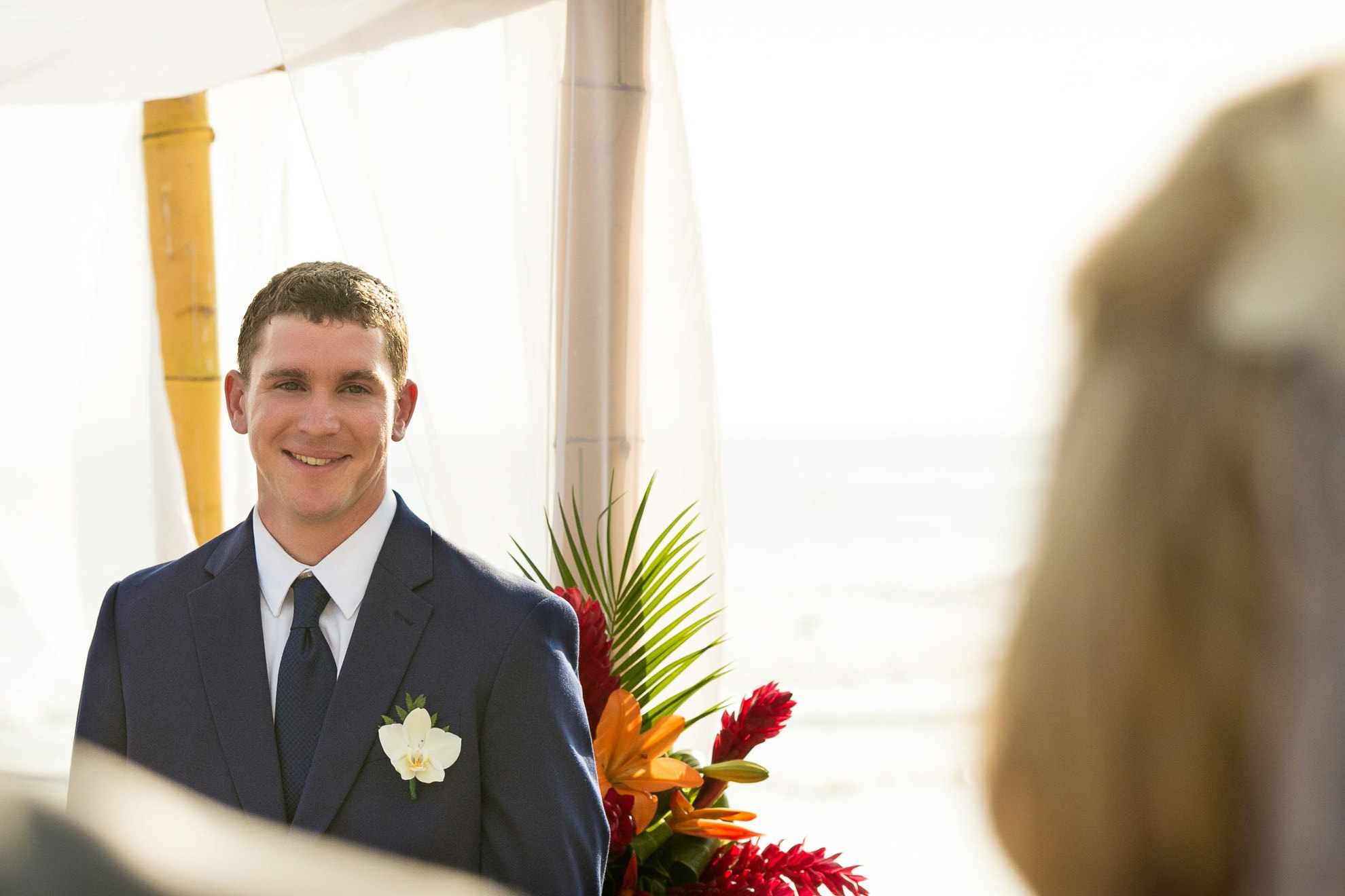 Groom sees bride in dress for the first time.