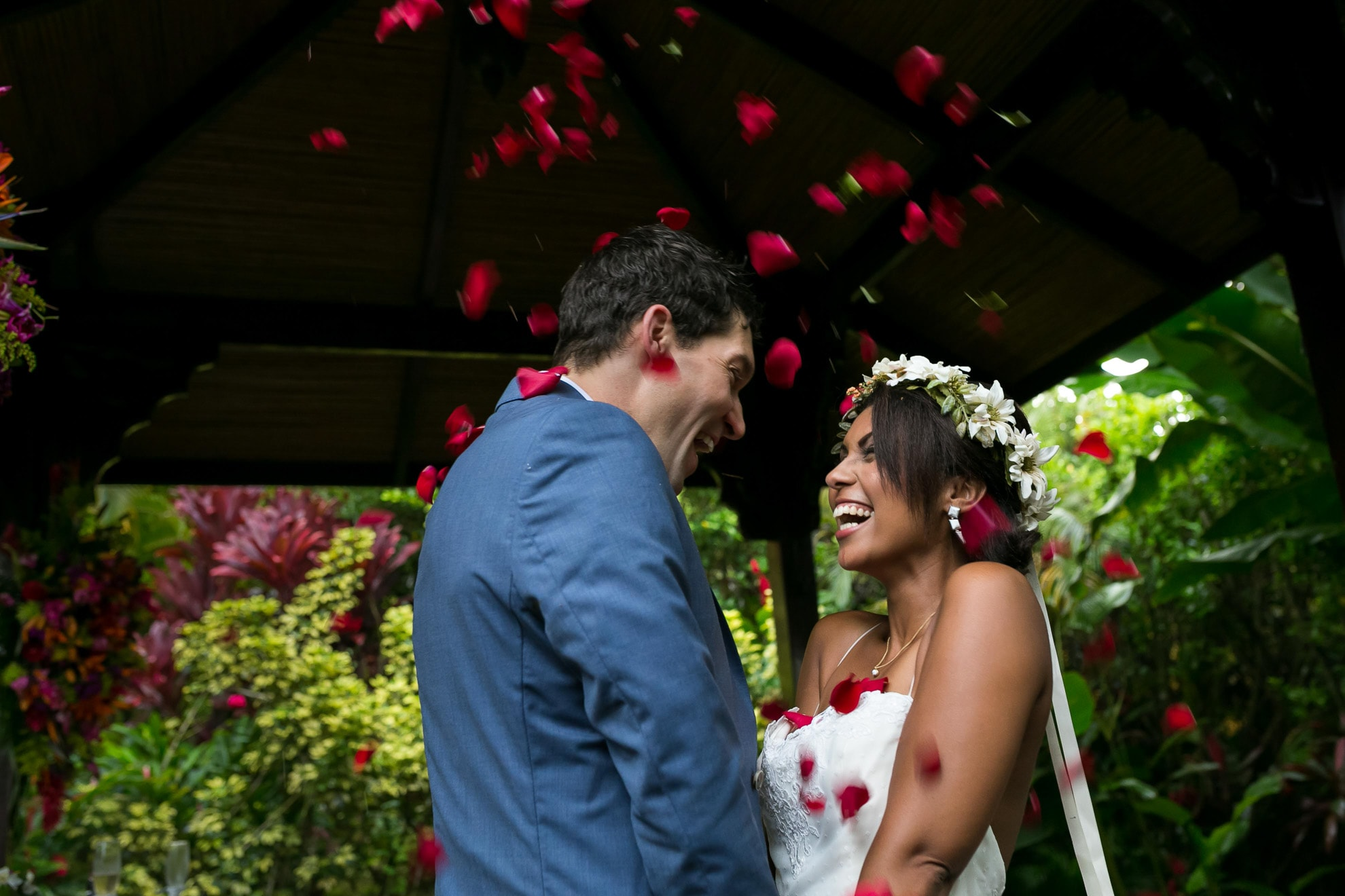 Throwing rose petals at wedding