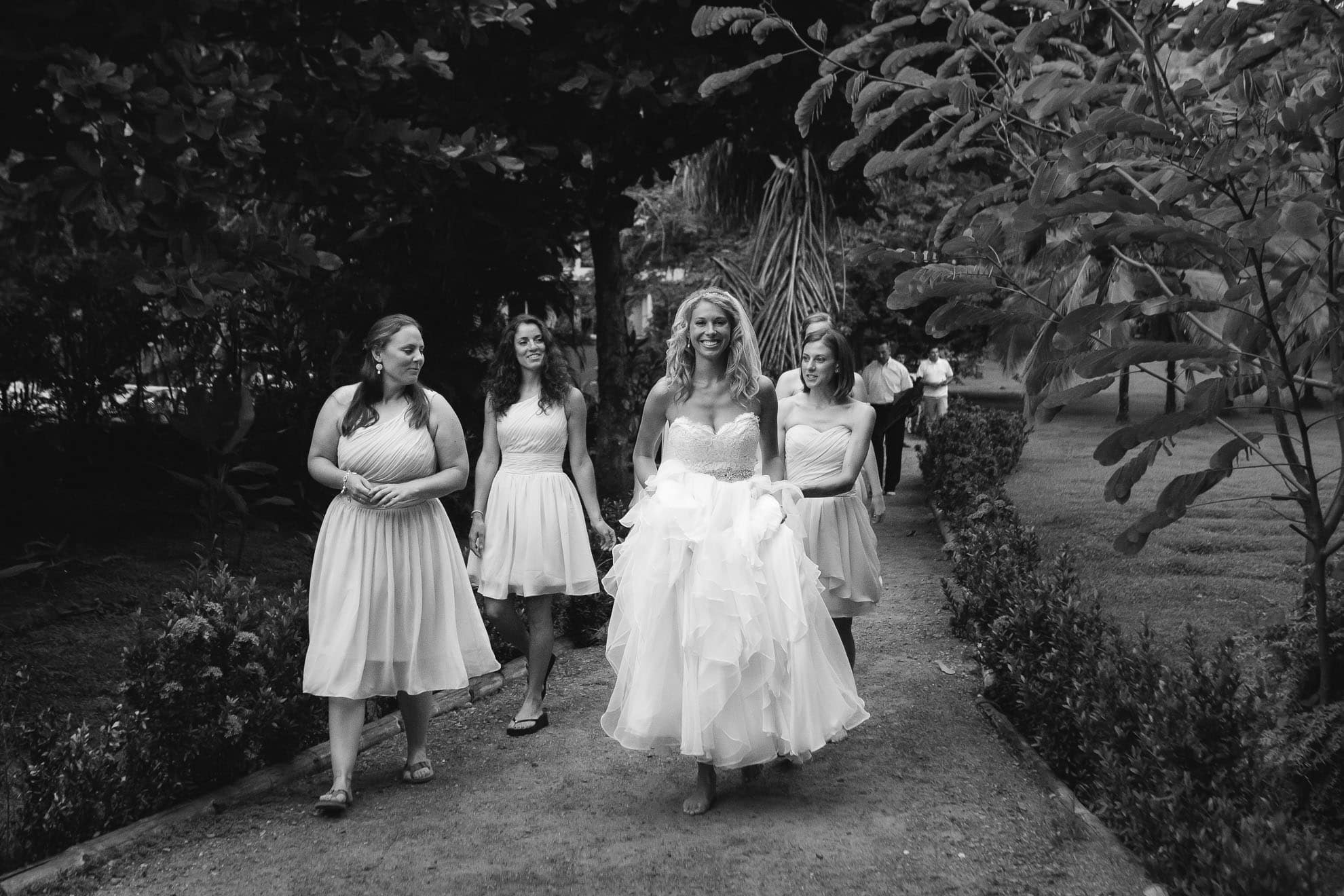 Bride walking to beach ceremony