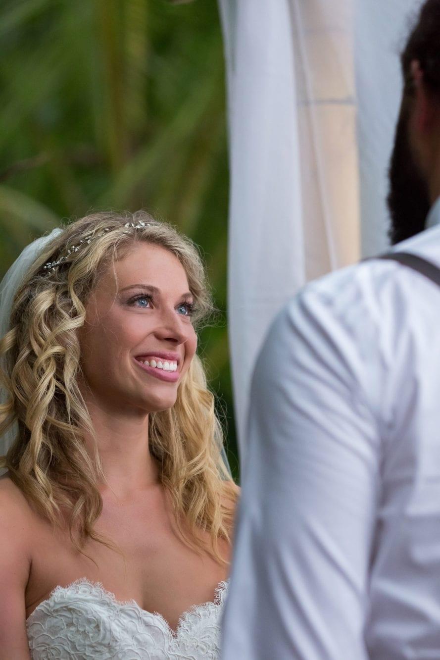 Bride looking at groom in Manuel Antonio