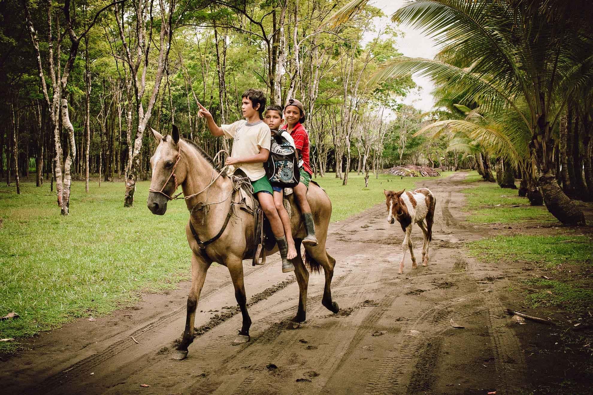 Horses on Kids at Playa Linda, Costa Rica