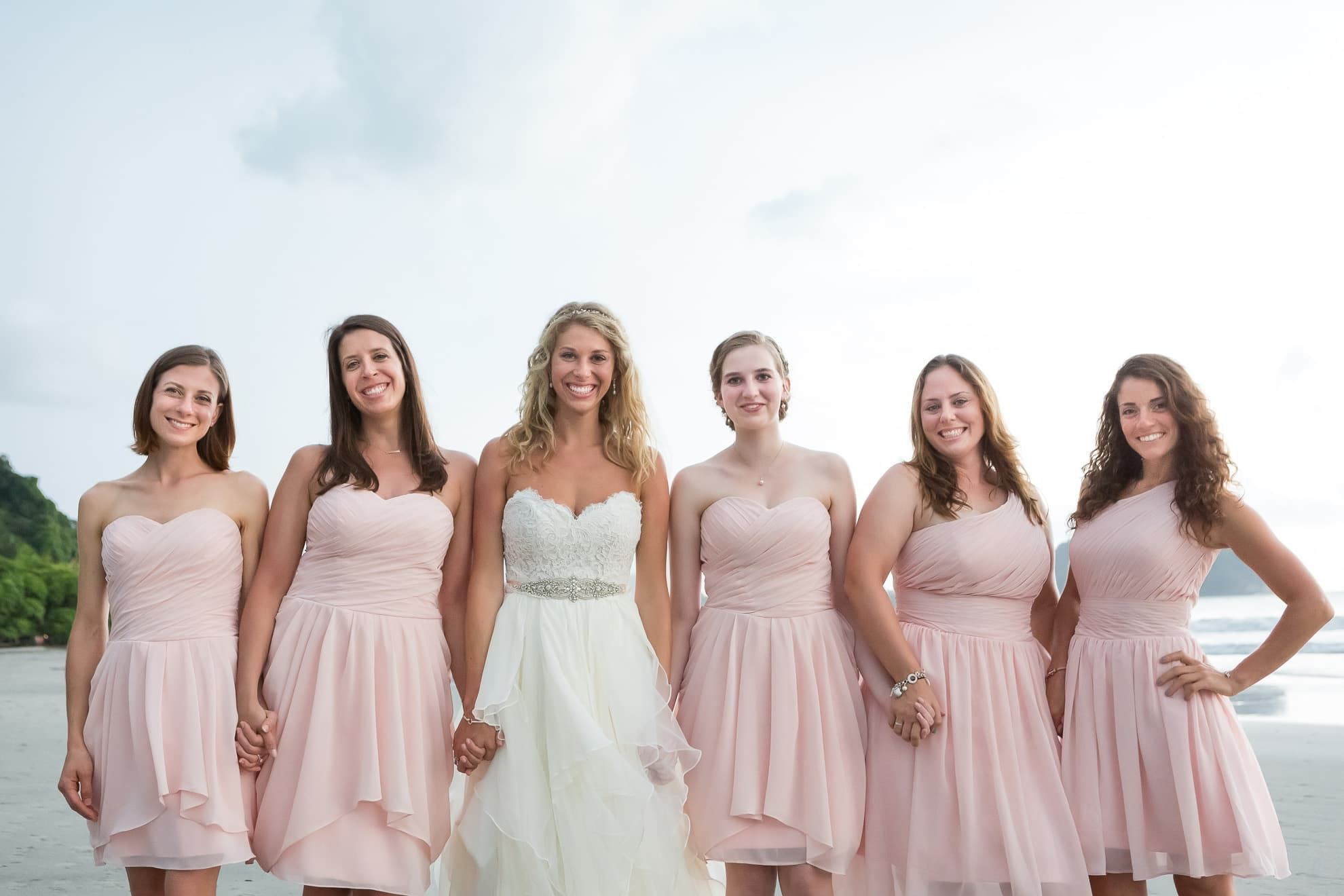 Bride with bridesmaids in Costa Rica at tropical beach wedding