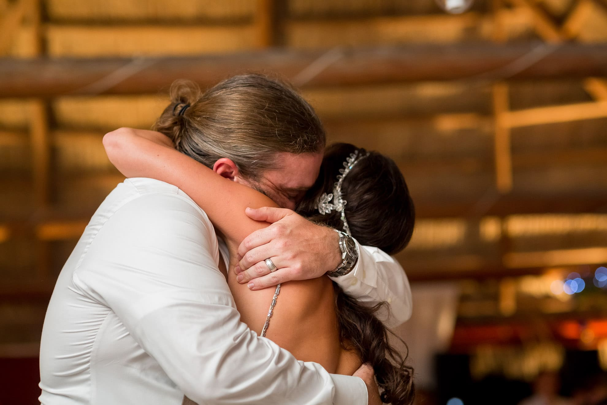 Brother hugs sister at wedding