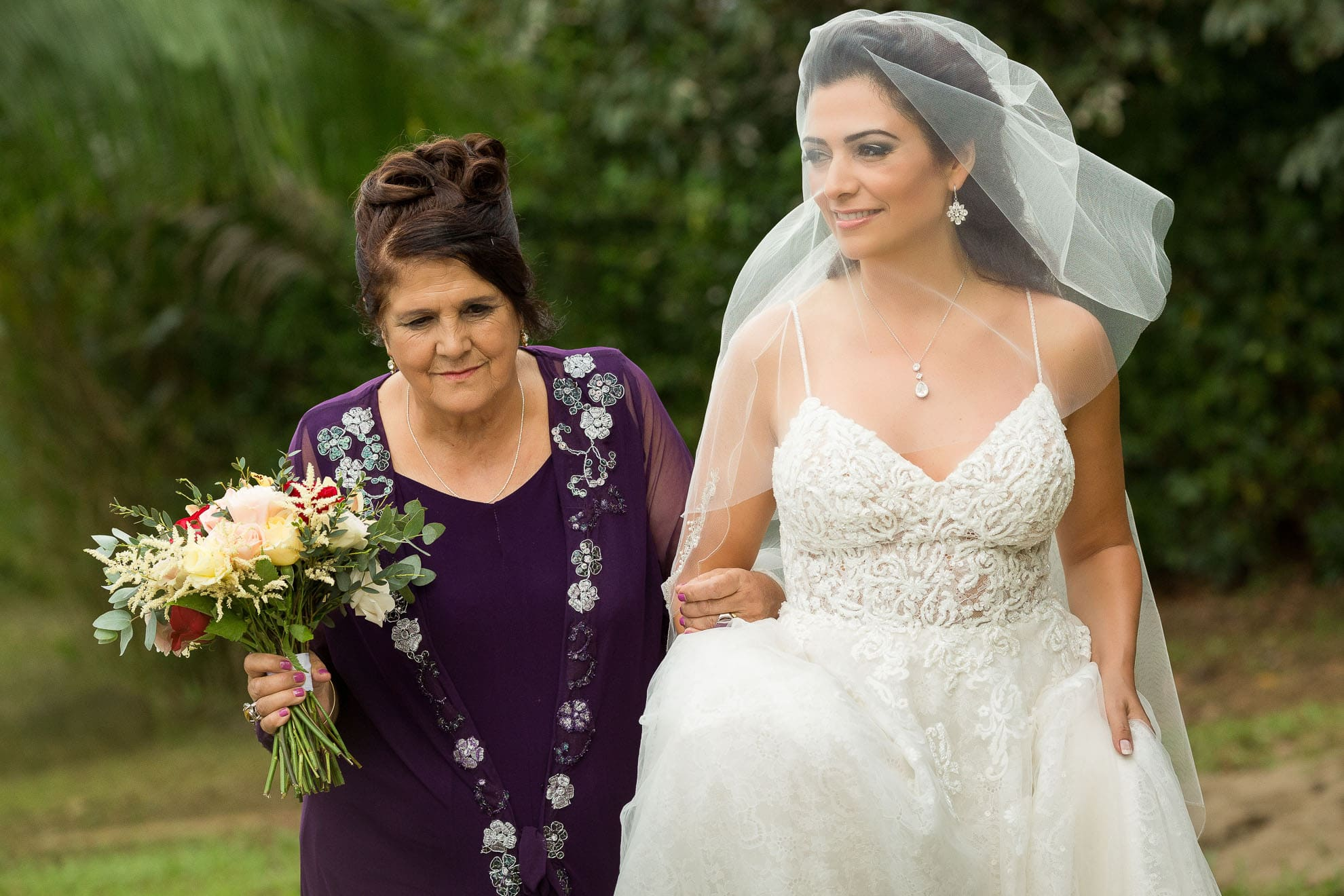 Mother walks bride down aisle