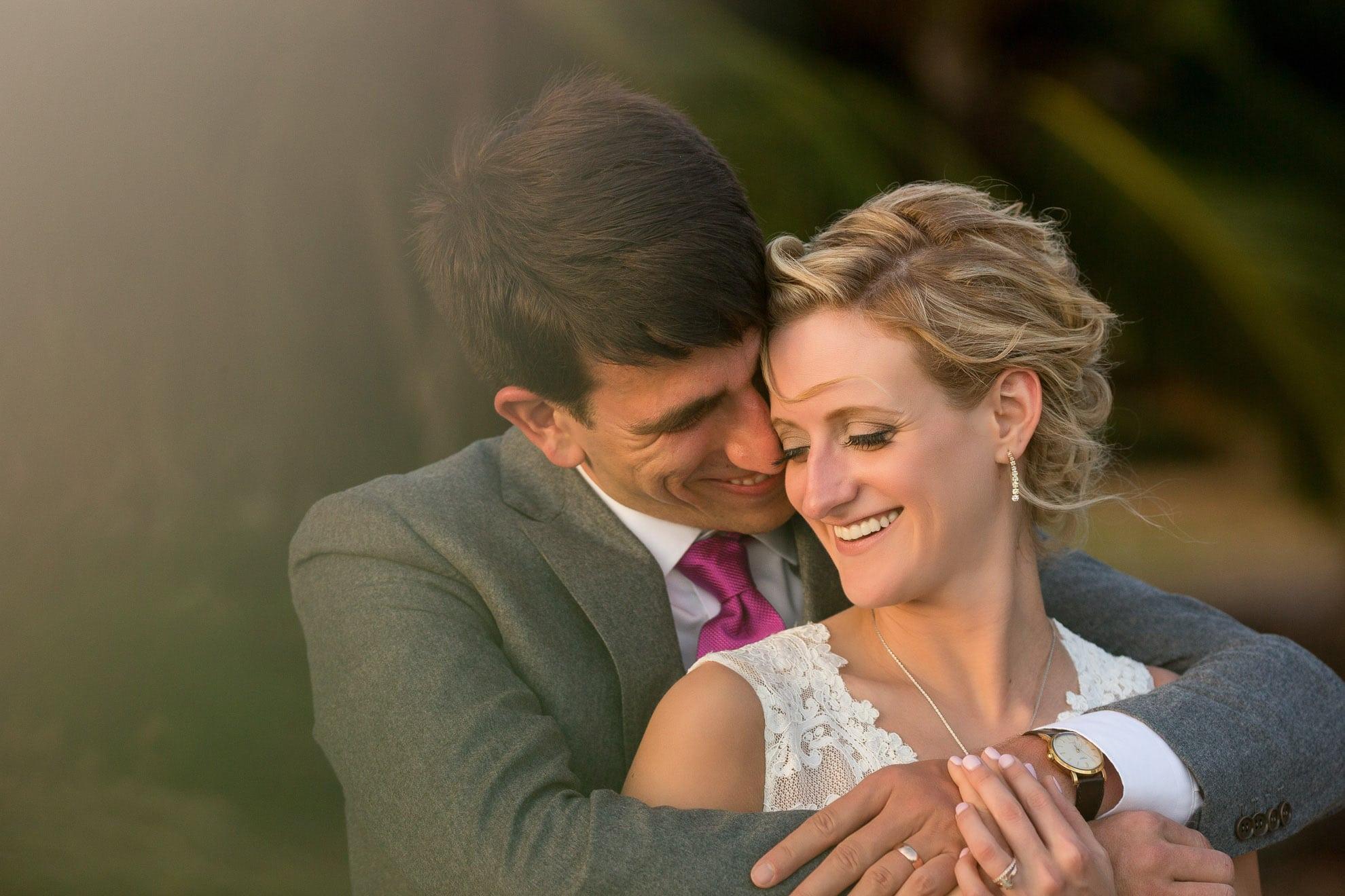 Groom hugging bride in destination Wedding at Gaia Hotel Manuel Antonio