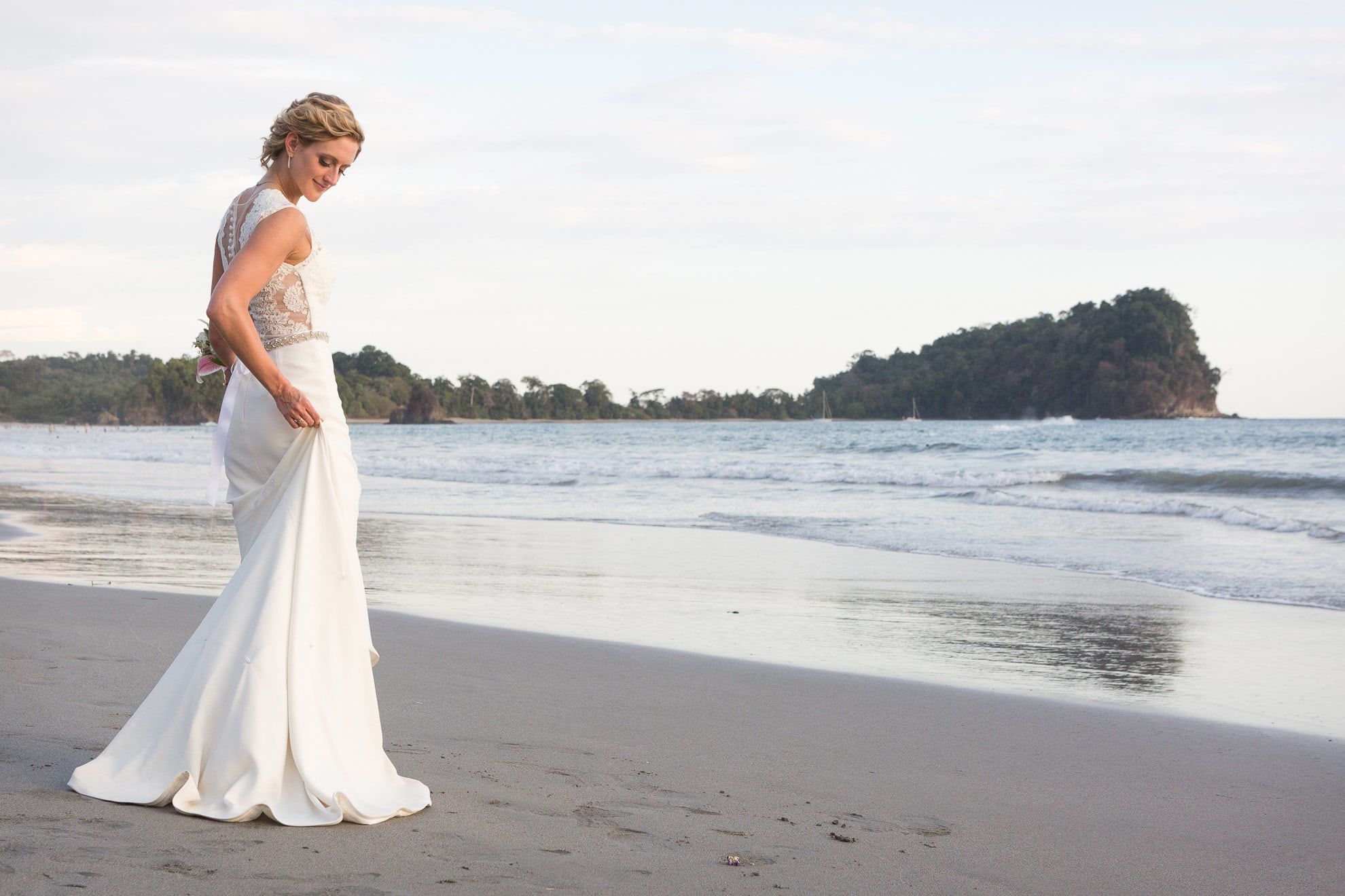 bride in dress on manuel antonio beach