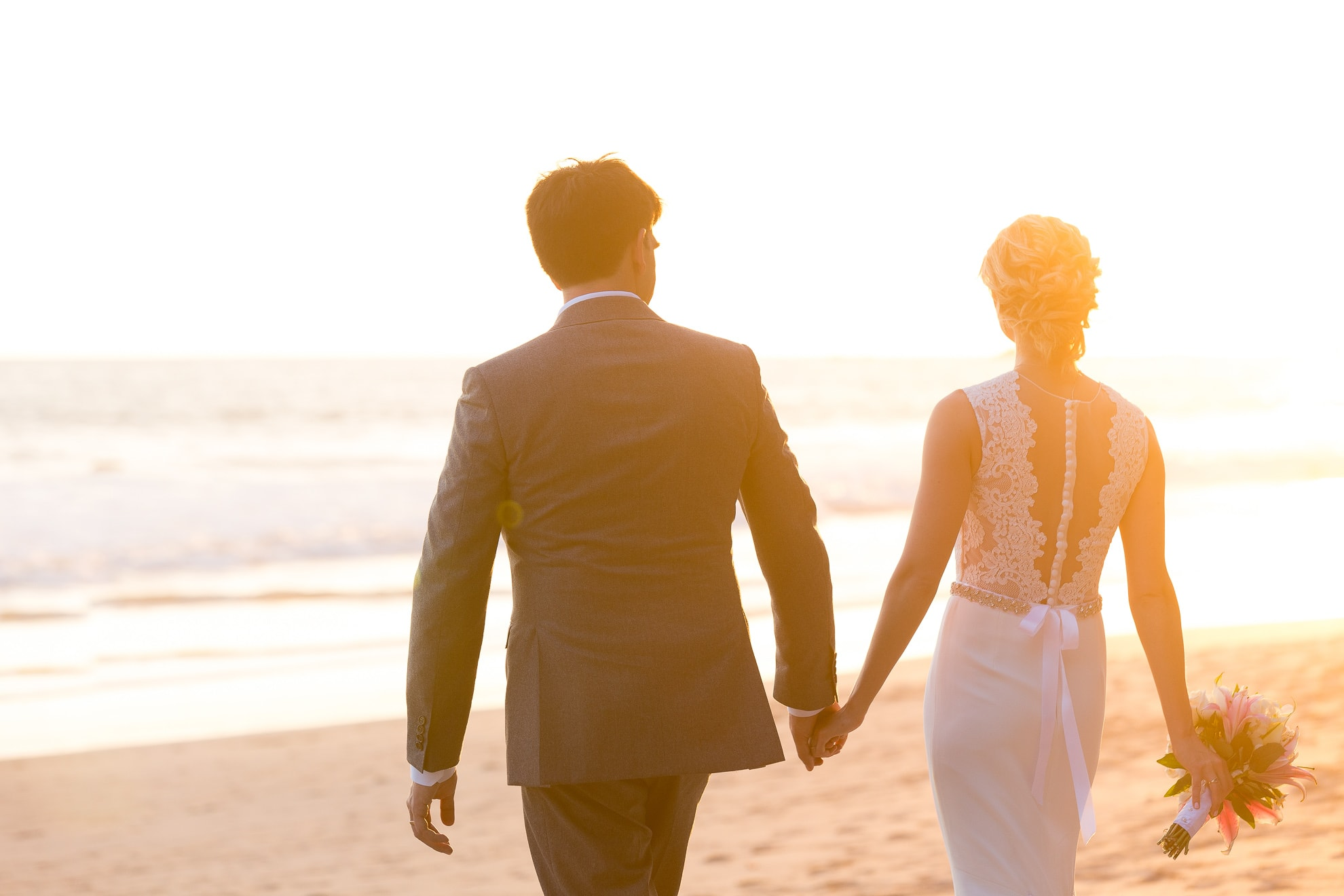 walking off into the sunset of their destination wedding