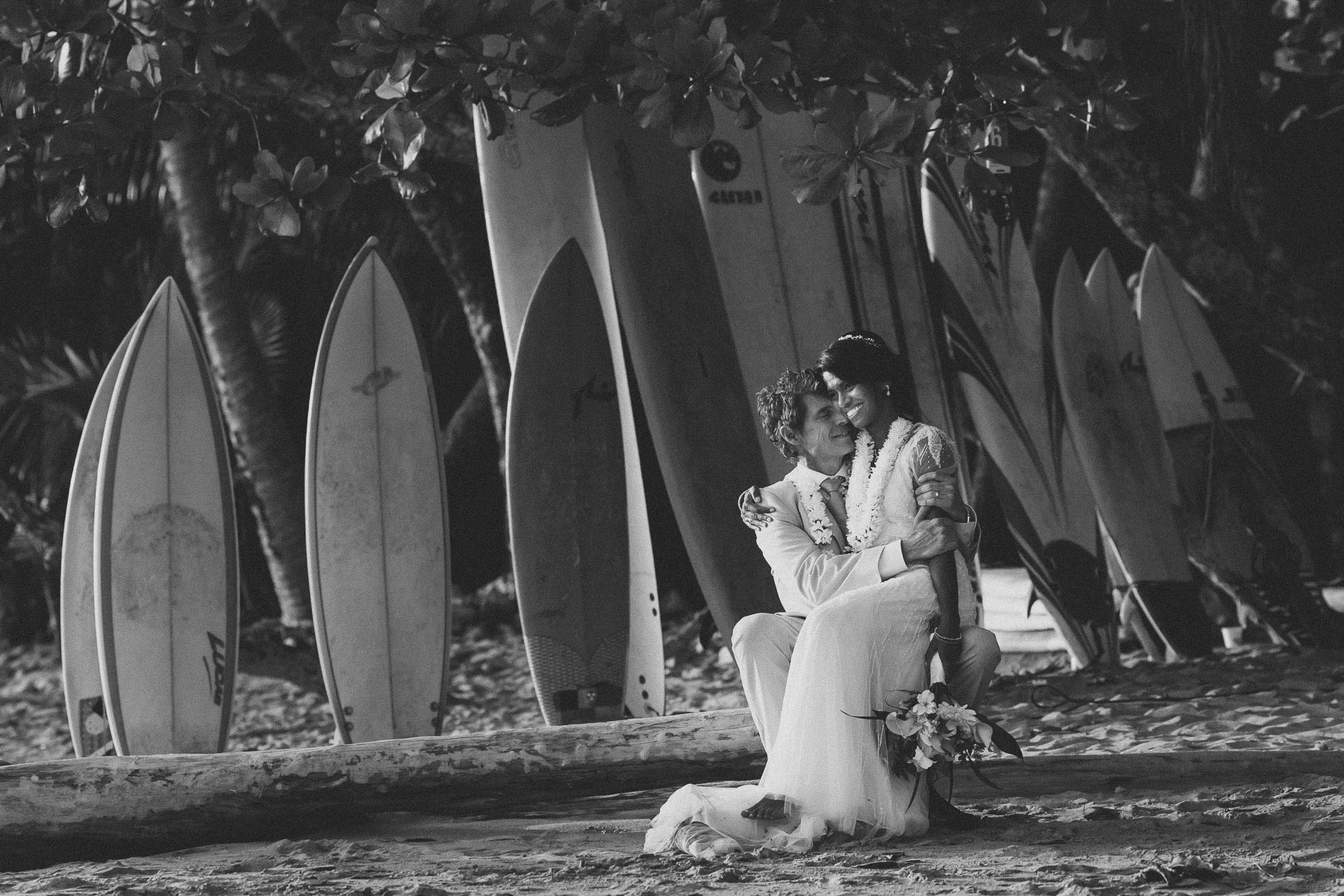 Bride and groom with surfboards
