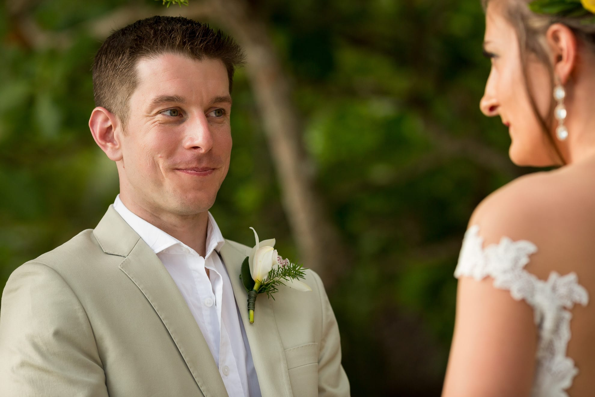 groom looking into bride's eyes during their vows