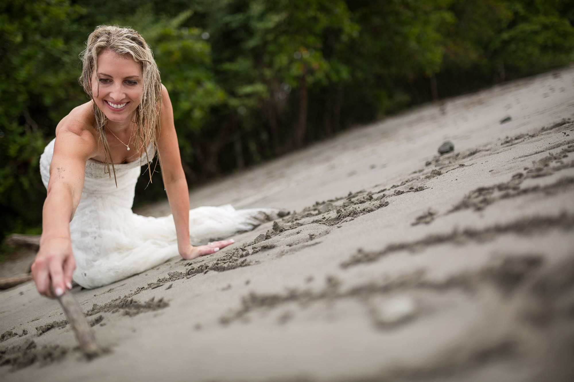 bride writing in sand