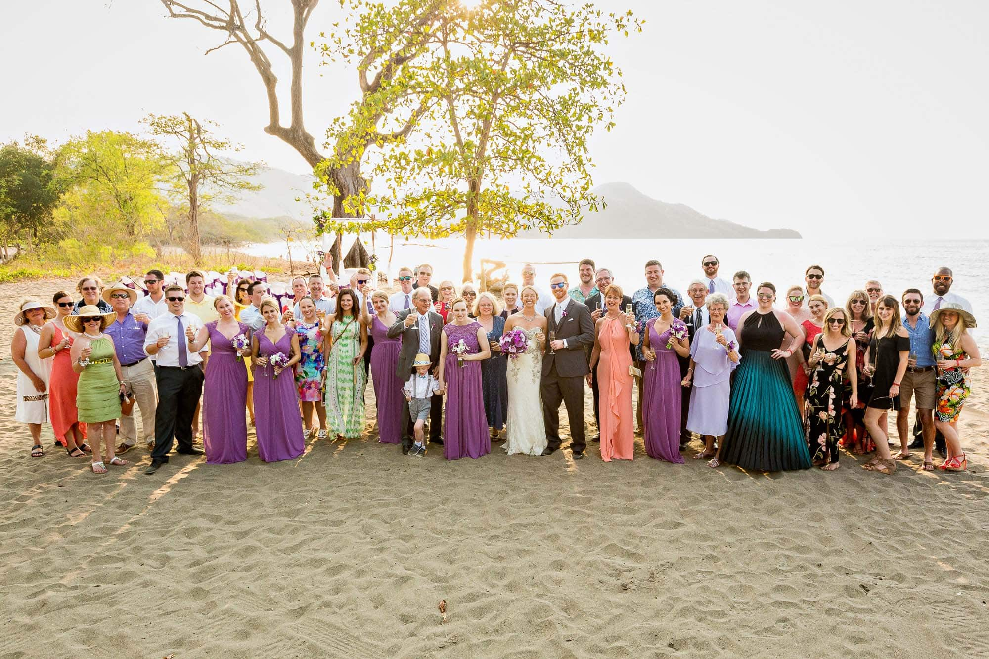 group photo on beach after wedding at riu palace costa rica