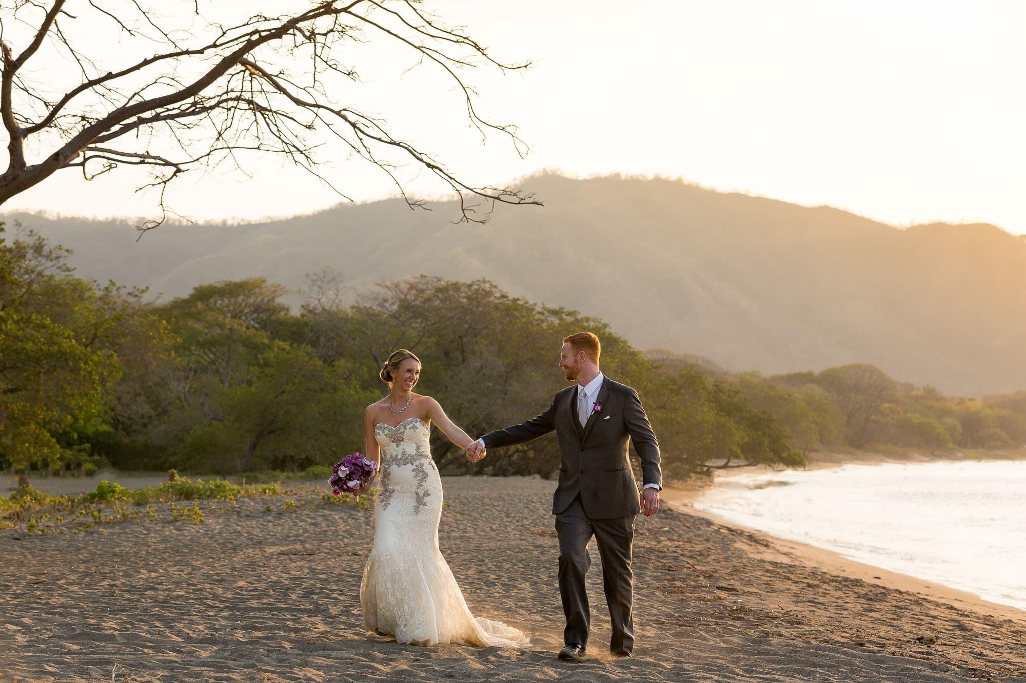 bride and groom on beach in riu guanacaste costa rica
