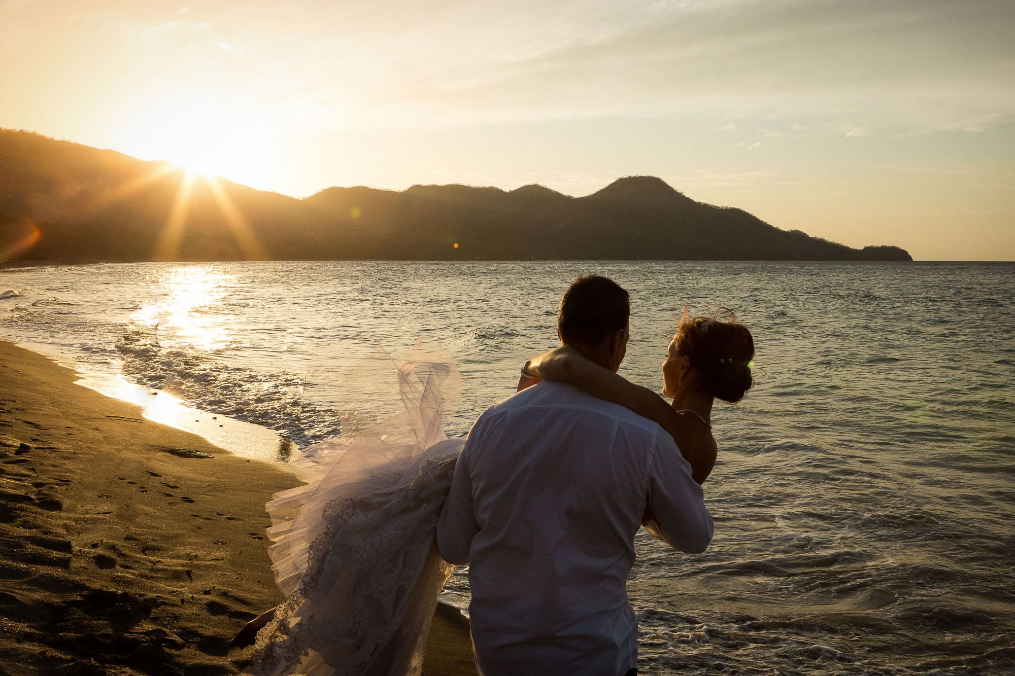 bride and groom at sunset on beach in guanacaste